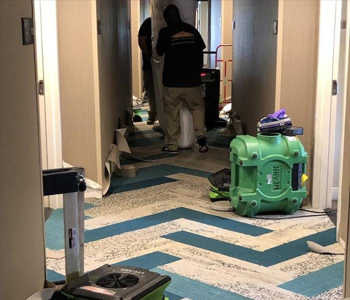 SERVPRO technicians and equipment at  work.