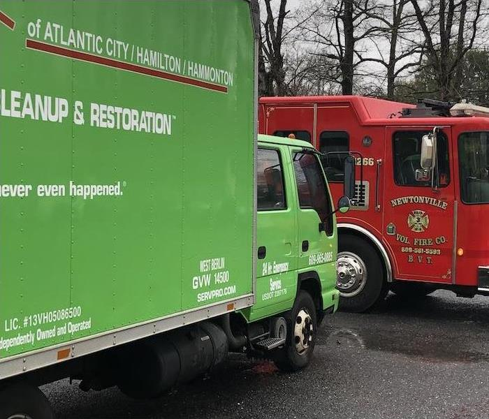 SERVPRO truck with a fire truck